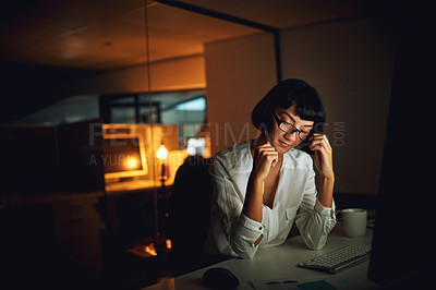 Buy stock photo Shot of a young businesswoman feeling tired during a late night at work