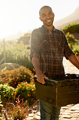 Buy stock photo Portrait of a young man working in a garden