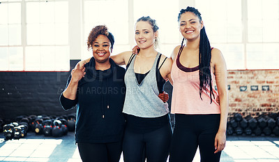 Buy stock photo Portrait of three cheerful young women having a conversation while looking into the camera before a workout session in a gym