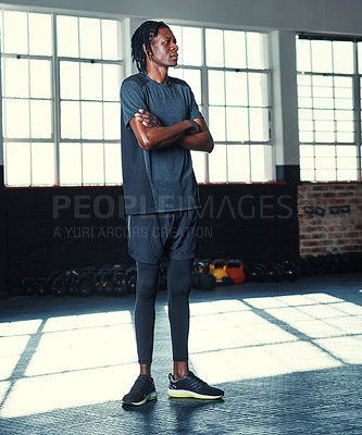 Buy stock photo Shot of a young man in a gym