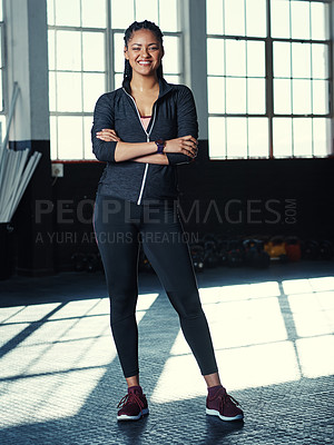 Buy stock photo Shot of a young woman in a gym