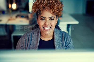 Buy stock photo Portrait of a young businesswoman working late in an office