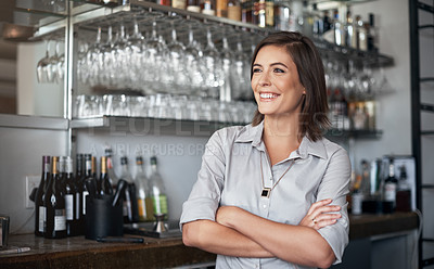 Buy stock photo Cropped shot of an attractive young woman standing with her arms crossed in her coffee shop