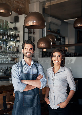 Buy stock photo Cropped portrait of two young entrepreneurs standing in the coffee shop