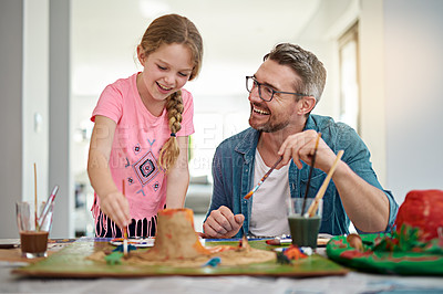Buy stock photo Cropped shot of a handsome man helping his daughter build a volcano for school