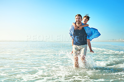 Buy stock photo Portrait of a father and his little son enjoying some quality time together at the beach