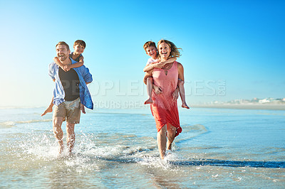 Buy stock photo Portrait of a happy family enjoying some quality time together at the beach