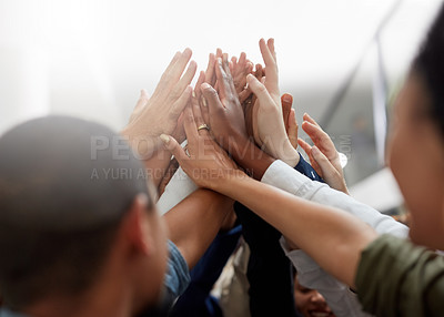 Buy stock photo Cropped shot of a group of businesspeople sharing a high-five