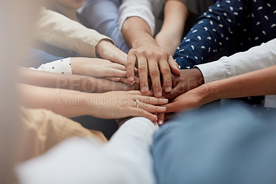 Buy stock photo Cropped shot of a group of businesspeople putting their hands together in a huddle