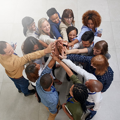 Buy stock photo High angle shot of a large group of businesspeople sharing a high-five