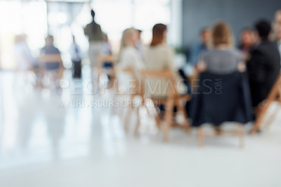 Buy stock photo Out of focus shot of a group businesspeople sitting down during a presentation inside of a boardroom
