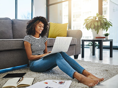 Buy stock photo Shot of a young woman working from home