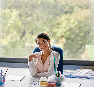 Buy stock photo Shot of young female teacher in a classroom