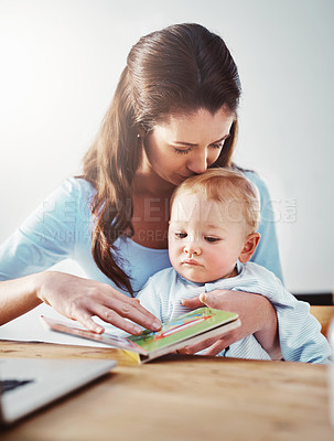 Buy stock photo Shot of a mother and her baby boy at home