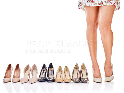 Buy stock photo Cropped shot of a woman standing next to a row of shoes