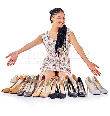Buy stock photo Shot of a young woman sitting with her collection of high heels