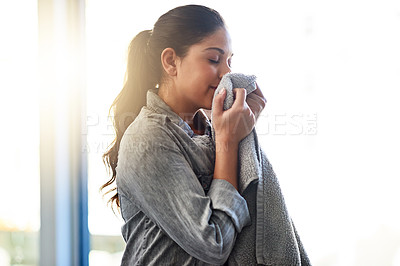 Buy stock photo Shot of a woman doing her daily chores at home
