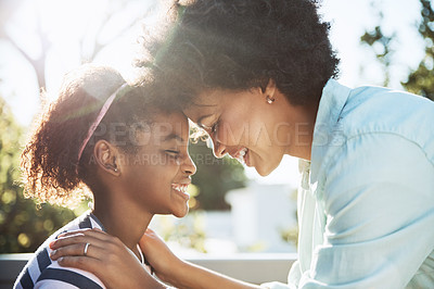 Buy stock photo Shot of a cheerful young mother and her daughter putting their heads together while keeping their eyes closed