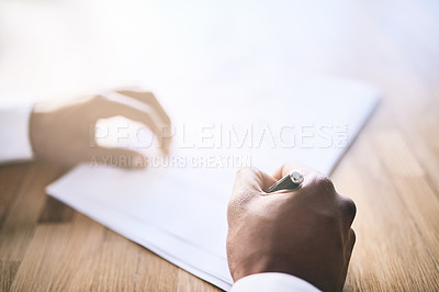 Buy stock photo Shot of a unrecognizable business person signing a document