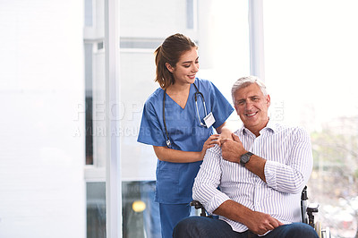 Buy stock photo Portrait of a cheerful young female doctor holding a patient's hand while the patient looks into the camera