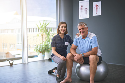 Buy stock photo Cropped portrait of a female physician working with a senior male patient