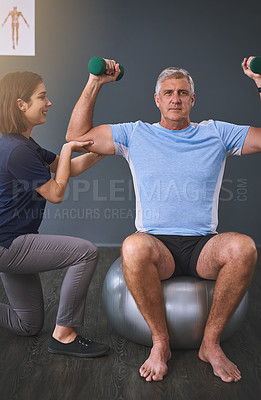 Buy stock photo Cropped shot of a female physician working with a senior male patient