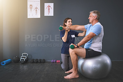 Buy stock photo Full length shot of a female physician working with a senior male patient