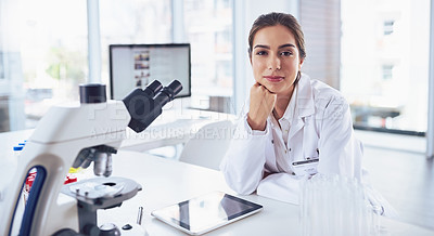 Buy stock photo Portrait of a confident young female scientist striking a pose while looking at the camera inside of a laboratory