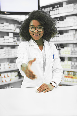 Buy stock photo Portrait of a cheerful young female pharmacist reaching out to shake hands while looking at the camera in a pharmacy