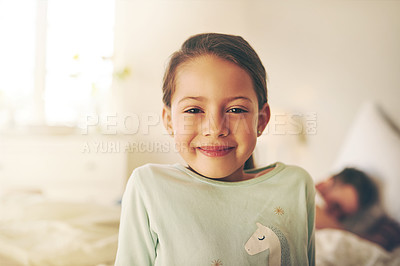 Buy stock photo Portrait of a cheerful little girl standing in a bedroom while looking at the camera at home