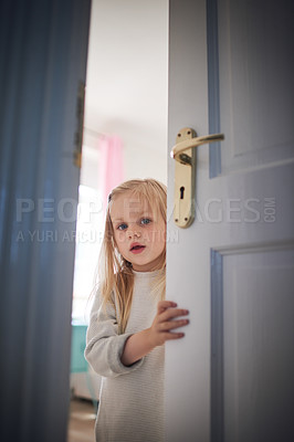 Buy stock photo Shot of an adorable little girl opening a door at home