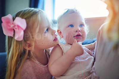 Buy stock photo Shot of two adorable sisters bonding with their mother at home