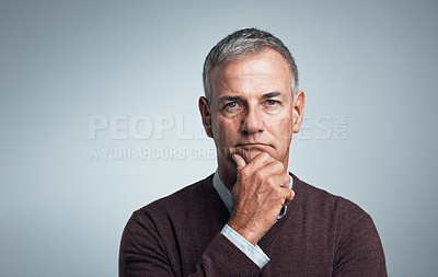 Buy stock photo Studio shot of a confident mature man against a gray background