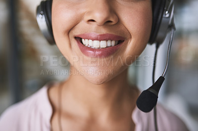 Buy stock photo Cropped shot of a cheerful unrecognizable businesswoman talking to customer using a headset