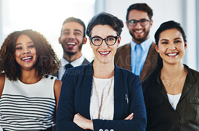 Buy stock photo Portrait of a diverse team of professionals standing together in an office