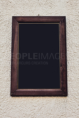 Buy stock photo Cropped shot of a blank sign hanging outside