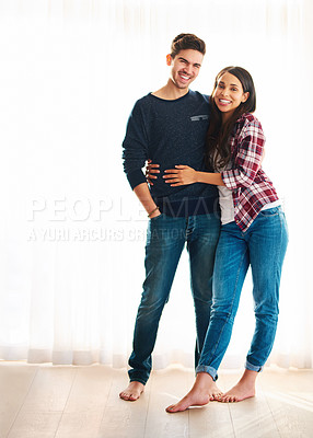 Buy stock photo Full length portrait of a handsome young man embracing his girlfriend in their home