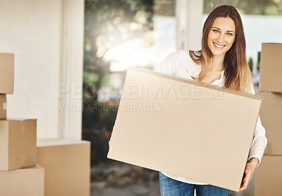 Buy stock photo Cropped portrait of an attractive young woman carrying a box on moving day