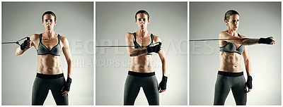 Buy stock photo Studio portrait of an athletic young sportswoman working out with a resistance band against a grey background