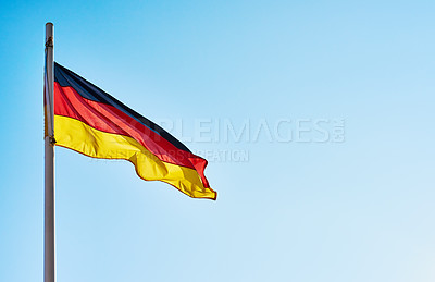 Buy stock photo Low angle shot of the German flag standing on its own outside during the day