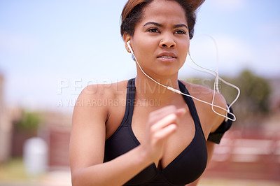 Buy stock photo Cropped shot of a beautiful young woman exercising outside