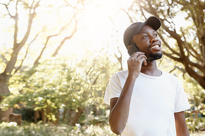 Buy stock photo Cropped shot of a handsome young man talking on his cellphone
