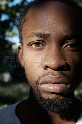 Buy stock photo Cropped portrait of a handsome young man posing outside