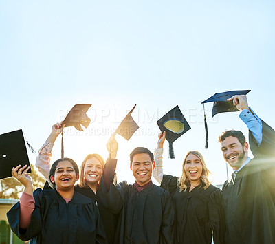 Buy stock photo Portrait of a group of students celebrating on graduation day