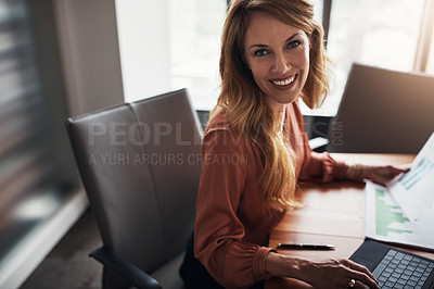Buy stock photo High angle portrait of an attractive businesswoman working in her corporate office