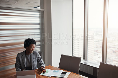 Buy stock photo High angle shot of an attractive businesswoman working in her corporate office