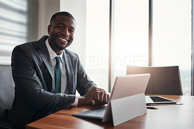 Buy stock photo Cropped portrait of a handsome businessman working in his corporate office