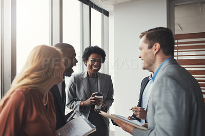 Buy stock photo High angle shot of a group of corporate businesspeople laughing during a meeting in their boardroom