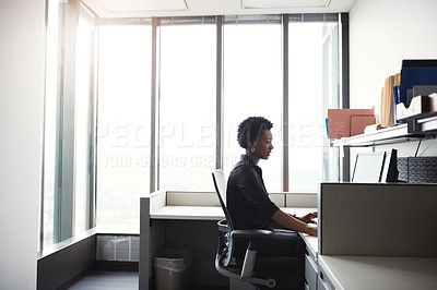 Buy stock photo Shot of a businesswoman working on her computer at her desk