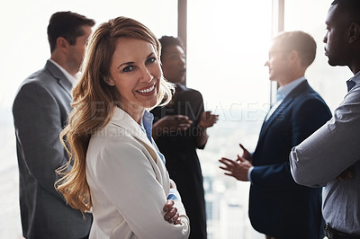 Buy stock photo Cropped portrait of an attractive businesswoman standing with her arms folded during a meeting in the boardroom